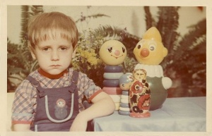 Sad 60's kid and toys